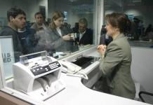 Ernst&Young: Grupurile bancare vor continua dezintermedierea în România, creditarea va stagna