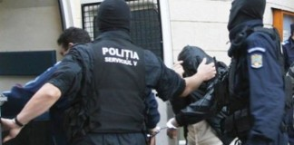 Doi ofiţeri de la Poliţia Sector 5, trimişi în judecată pentru luare de mită