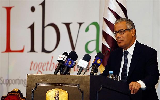 Amenințat cu arma în propriul birou, premierul Libiei remaniază guvernul
