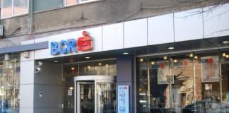 Rețeta de succes a BCR pe o piață a creditării blocată: Comisioane mai mari, angajați mai puțini