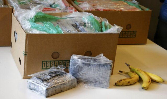Confiscated cocaine packed in banana boxes are displayed during a new conference in Berlin