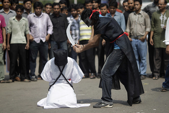 Members of Magic Movement, a group of young Bangladeshis, stage a mock execution scene in protest of Saudi Arabia beheading of eight Bangladeshi workers in front of National Museum in Dhaka