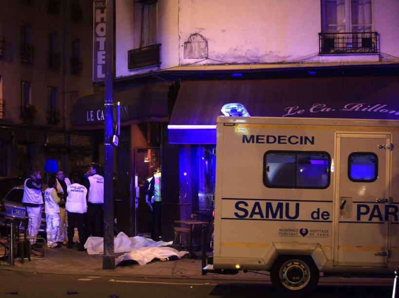 Medical staff stand by victims in a Paris restaurant, Friday, Nov. 13, 2015. Two police officials say at least 11 people have been killed in shootouts and other violence around Paris. Police have reported shootouts in at least two restaurants in Paris. At least two explosions have been heard near the Stade de France stadium, and French media is reporting of a hostage-taking in the capital. (AP Photo/Thibault Camus)/PAR113/504373550026/1511132305