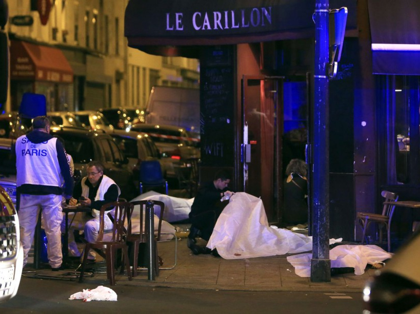 Victims lay on the pavement in a Paris restaurant, Friday, Nov. 13, 2015. Police officials in France on Friday reported a shootout in a Paris restaurant and an explosion in a bar near a Paris stadium. It was unclear if the events were linked. (AP Photo/Thibault Camus)/PAR108/565388288421/1511132254