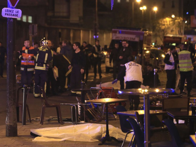 Rescue workers and medics work by victims in a Paris restaurant, Friday, Nov. 13, 2015. Police officials in France on Friday reported a shootout in a Paris restaurant and an explosion in a bar near a Paris stadium. It was unclear if the events were linked. (AP Photo/Thibault Camus)/PAR106/43061782385/1511132249